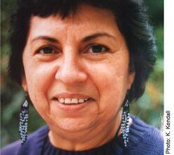 An image of the Chicana critic Gloria Anzaldua, smiling.