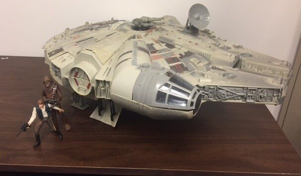 A model of the Millennium Falcon with Han Solo and Chewbacca figures.