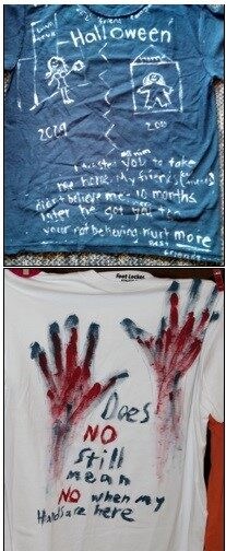 Two shirts, one blue and one white. One has drawings in white, the other, handprints in red.