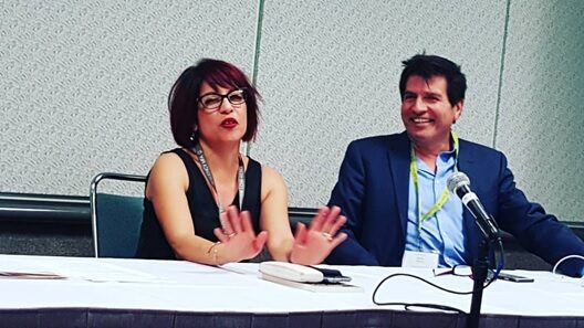 An image of Michelle Gonzales speaking on a panel.